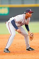 Danville Braves third baseman Carlos Franco (11) on defense against the Burlington Royals at Burlington Athletic Park on July 18, 2012 in Burlington, North Carolina.  The Royals defeated the Braves 4-3 in 11 innings.  (Brian Westerholt/Four Seam Images)