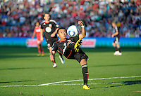 DC United midfielder Andy Najar (14) makes an acrobatic clearance.  The Chicago Fire tied DC United 0-0 at Toyota Park in Bridgeview, IL on Oct. 16, 2010.