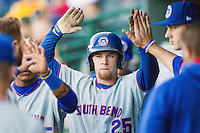 South Bend Cubs third baseman Jesse Hodges (25) celebrates in the dugout after scoring against the Great Lakes Loons on May 18, 2016 at Dow Diamond in Midland, Michigan. Great Lakes defeated South Bend 5-4. (Andrew Woolley/Four Seam Images)