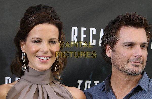 "Kate Beckinsale, Len Wiseman.""Total Recall"" - Los Angeles Photo Call Held at The Four Seasons Hotel, Beverly Hills, California, USA, 28th July 2012..portrait headshot hair up earrings beige nude brown high neck husband wife couple .CAP/ADM/KB.©Kevan Brooks/AdMedia/Capital Pictures."