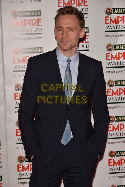 Tom Hiddleston.The 18th Jameson Empire Film Awards at Grosvenor House, London, England..March 24th, 2013.half length black white shirt suit tie blue hands in pockets stubble facial hair .CAP/PL.©Phil Loftus/Capital Pictures.
