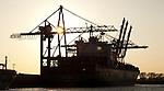 Hamburg-Germany - May 04, 2013 -- Port of Hamburg / harbour at the river Elbe: container cranes and ship at HHLA, Hamburger Hafen und Logistik Aktiengesellschaft, Infrastructure -- Photo: © HorstWagner.eu
