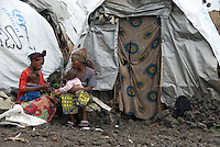 Mothers sit and chat outside their shelters in the Mugunga I IDP (Internally Displaced Persons) camp.