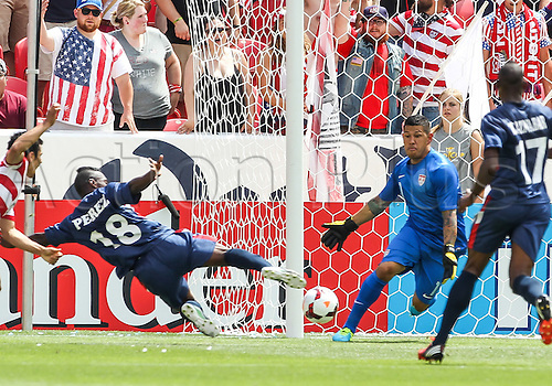 13.07.2013. Sandy, Utah, USA. Cuba midfielder Liban Perez (18) dives to shoot on US Men's National goal keeper Nick Rimando (1)during the CONCACAF Gold Cup soccer match between USA Men's National team and Cuba at Rio Tinto Stadium in Sandy, UT. USA.