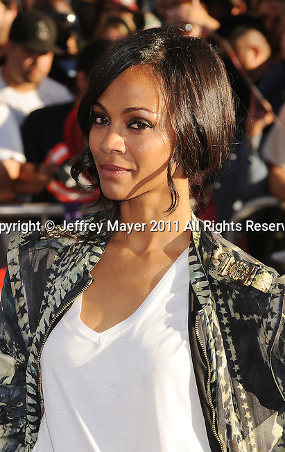 """HOLLYWOOD, CA - JULY 19: Zoe Saldana attends the Los Angeles Premiere of """"Captain America: The First Avenger"""" at the El Capitan Theatre on July 19, 2011 in Hollywood, California."""