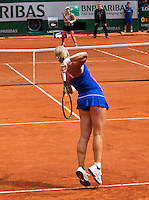 Paris, France, 24 June, 2016, Tennis, Roland Garros,  Kiki Bertens (NED) forground upset 13h seat Kerber of Germany in the first round<br /> Photo: Henk Koster/tennisimages.com