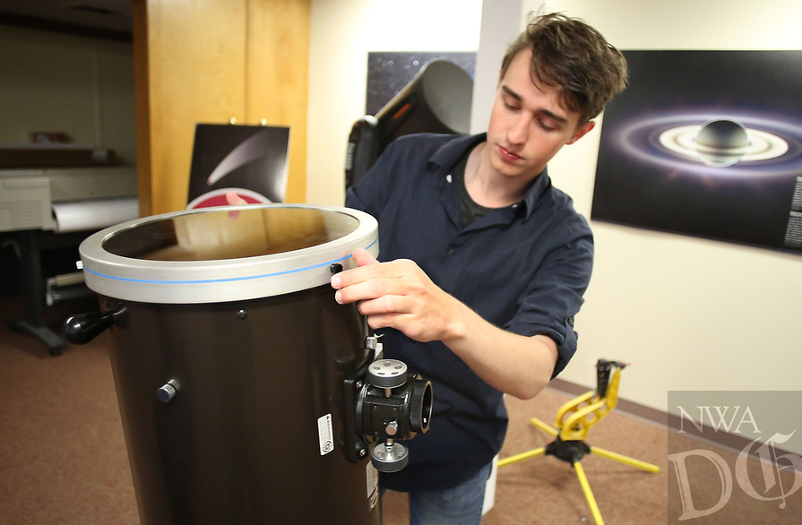 NWA Democrat-Gazette/DAVID GOTTSCHALK   Brett Bonine, president elect of Space and Planetary Association for Collaboration and Education Hogs, the astronomy club at the University of Arkansas, displays Tuesday, August 1, 2017, a newtonian telescope that equipped with a solar filter to allow him to view the solar eclipse. Bonine will be traveling to Missouri with members of SPACE Hogs to view the Total Eclipse of the Sun 2017 as it occurs on Monday, August 21.
