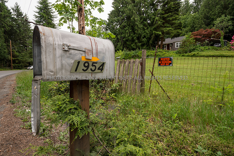 5/30/2015&mdash;Port Orchard, Washington, USA<br /> <br /> <br /> The home at 1954 woods road SE, Port Orchard, Washington State, that Melford Warren Jr., 43, lived with his two lovers, Shannon Felicia Ann Smith, 41, and Amanjot Kaur Jaswal, 28. Warren has been charged with child rape and related crimes on allegations stemming from his family&rsquo;s stay at this Port Orchard home.<br /> <br /> <br /> Photograph by Stuart Isett<br /> &copy;2014 Stuart Isett. All rights reserved.