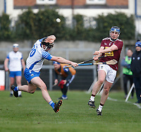 2nd February 2020; TEG Cusack Park, Mullingar, Westmeath, Ireland; Allianz Division 1 Hurling, Westmeath versus Waterford; Eoin Price (Westmeath) plays the ball forward as Jake Dillon (Waterford) tries to block