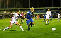 AFC Wimbledon's Lyle Taylor  holds off Milton Keynes' Scott Wootton during the Sky Bet League 1 match between AFC Wimbledon and MK Dons at the Cherry Red Records Stadium, Kingston, England on 22 September 2017. Photo by Carlton Myrie / PRiME Media Images.