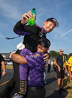 Sep 3, 2017; Clermont, IN, USA; NHRA funny car driver Jack Beckman celebrates with crew members after winning the Traxxas Shootout specialty race during qualifying for the US Nationals at Lucas Oil Raceway. Mandatory Credit: Mark J. Rebilas-USA TODAY Sports