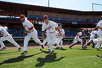 Ball State Cardinals players, including Maverick Bacon (14) and Seth Freed (1), take the field for practice before a game against the Louisville Cardinals on February 19, 2017 at Spectrum Field in Clearwater, Florida.  Louisville defeated Ball State 10-4.  (Mike Janes/Four Seam Images)