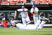 Buffalo Bisons shortstop Luis Figueroa #9 on the ground after falling down while running out of the batters box on a foul ball during a game against the Charlotte Knights at Dunn Tire Park on May 22, 2011 in Buffalo, New York.  Buffalo defeated Charlotte by the score of 7-5.  Photo By Mike Janes/Four Seam Images