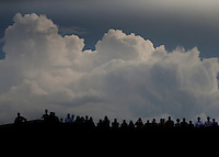 Jun 19, 2015; Bristol, TN, USA; Storm clouds build behind fans atop the tower during NHRA qualifying at the Thunder Valley Nationals at Bristol Dragway. Mandatory Credit: Mark J. Rebilas-