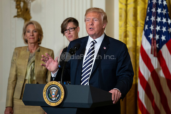 United States President Donald J. Trump speaks during the National Teacher of The Year ceremony in the East Room of the White House in Washington, DC n May 2, 2018. Credit: Alex Edelman / CNP /MediaPunch