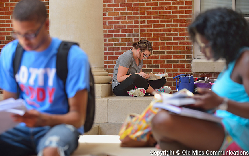 Samantha Hopper finds a quiet place to study for finals. Photo by Thomas Graning/Ole Miss Communications