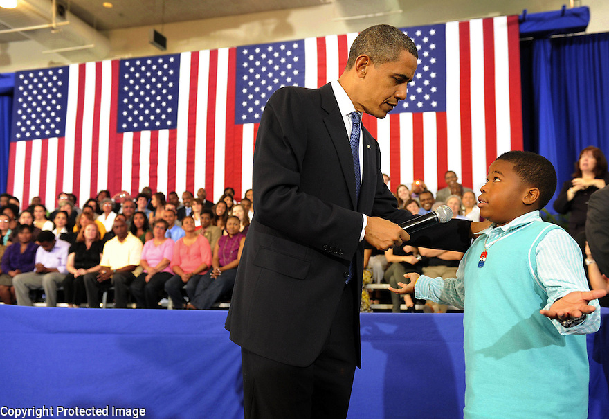 U.S. President Barack Obama lets nine-year-old Tyren Scott ask why people are so hateful toward the president at a town hall event at The University of New Orleans  in New Orleans, Louisiana, USA 15 October, 2009. Obama and members of his Cabinet toured areas of the city and met with students and residents still suffering from the effects of Hurricane Katrina that devastated the area more than four years ago.