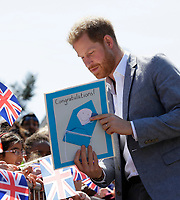 14 May 2019 - Prince Harry Duke of Sussex, is given a congratulations card as he meets members of the public as he arrives for a visit to Barton Neighbourhood Centre in Oxford. The centre is a hub for local residents which houses a doctor's surgery, food bank, cafe and youth club. Photo Credit: ALPR/AdMedia