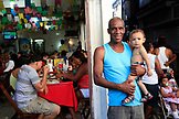 BRAZIL, Rio de Janiero, an older man and young boy in the Marketplace, Feria de Sao