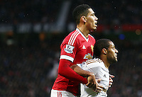 Chris Smalling of Manchester United and Wayne Routledge of Swansea City during the Barclays Premier League match between Manchester United and Swansea City played at Old Trafford, Manchester on January 2nd 2016