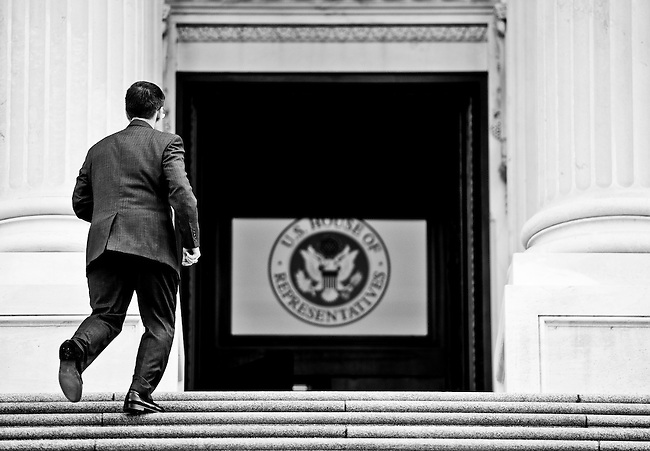 Rep. Heck races up the House steps to cast his vote on the contentious debt ceiling bill in the House of Representatives on Aug. 1, 2011. (Photo By Bill Clark/Roll Call)