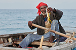 A year after Hurricane Matthew ravaged parts of Haiti, Herbert Louis displays his catch as he continues fishing off the coast of northwestern Haiti near the village of Plateforme. The village was devastated in the storm, and Lutheran World Relief, a member of the ACT Alliance, has helped the community rebuild its economy with fishing materials, a solar-powered refrigerator room for storing their catch, and other assistance.