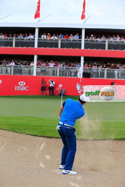 Rory McIlroy (NIR) chips from a bunker onto the 18th green during Sunday's Final Round of the Abu Dhabi HSBC Golf Championship 2015 held at the Abu Dhabi Golf Course, United Arab Emirates. 18th January 2015.<br /> Picture: Eoin Clarke www.golffile.ie