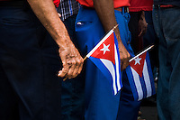 Cuban men carry the national flags during the celebration of the Cuban Revolution anniversary in Santiago de Cuba, Cuba, 26 July 2008. The Cuban revolution began when the poorly armed Cuban rebels, led by Fidel Castro, attacked the Moncada Barracks in Santiago de Cuba on 26 July 1953. The attack was easily defeated and most of the rebels were captured and later executed by the Batista regime. Although Fidel Castro had been sentenced to 15 years of prison, after less than two years he was released, he went to Mexico and in 1956, back in Cuba again, his guerilla group started a new rebellion.