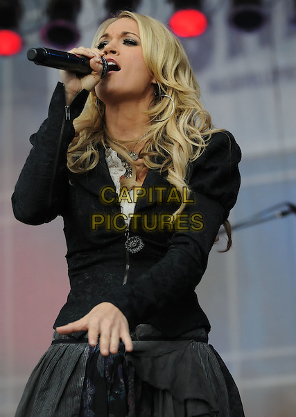 CARRIE UNDERWOOD.Carrie Underwood Performs on ABC's 'Good Morning America' at the Sommet Center, Nashville, Tennessee, USA..November 10th, 2009.half length stage concert live gig performance music black jacket grey gray skirt singing hand.CAP/ADM/LF.©Laura Farr/AdMedia/Capital Pictures.