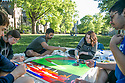 On the Abele Quad, from left, Jesse Pollack, senior, Carly Mirable, junior, Adarsh Nellore, junior, Kelsey Graywill, senior, and Kunaal Sharma, junior, work on a paint-by-number mural that will soon hang in the Student Wellness Center. The mural is part of a series that embodies different branches of wellness - this one being spiritual - created by duARTS.