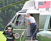 United States President Barack Obama waves to guests of White House staff as he boards Marine 1 to begin his summer vacation on the South Lawn of the White House in Washington, D.C. in Martha's Vineyard on Thursday, August 19, 2010..Credit: Ron Sachs / Pool via CNP