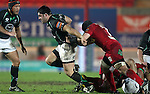 Ronan Loughney comes away from breakdown with Johnathan Edwards in pursuit..RaboDirect Pro12.Scarlets v Connacht.02.03.12.©STEVE POPE