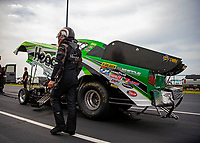 May 18, 2018; Topeka, KS, USA; NHRA funny car driver Jonnie Lindberg walks to his car during qualifying for the Heartland Nationals at Heartland Motorsports Park. Mandatory Credit: Mark J. Rebilas-USA TODAY Sports