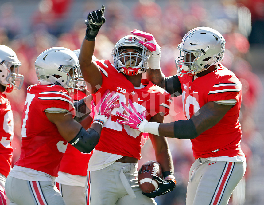 Ohio State Buckeyes safety Tyvis Powell (23) celebrates his interception against Maryland Terrapins offense in the fourth quarter of their game in Ohio Stadium on October 10, 2015.  (Dispatch photo by Kyle Robertson)