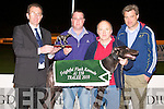 TOP DOG: Declan Dowling presenting the winning trophy to William Bulter owner of Croom Upper winner of the Frightful Flash Kennels Sweepstake Final at the Kingdom Greyhound stadium on Saturday l-r: Declan Dowling (sales and operations managers KGS), William Bulter, Neilus O'Connell (trainer) and Liam Trimble.
