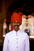 India, Rajasthan, Jaipur, City Palace, smiling turbaned guard