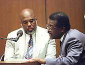 Lead defense attorney Johnnie L. Cochran, Jr., right, questions witness Howard L. Bingham, left, during the trial of former NFL star running back O.J. Simpson for the murder of his former wife, Nicole Brown Simpson and a friend of hers, restaurant waiter, Ron Goldman in Los Angeles County Superior Court in Los Angeles, California on July 13, 1995.<br /> Credit: Steve Grayson / Pool via CNP