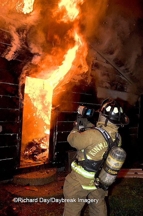 63818-020.17 Firefighter using thermal imaging camera at house fire,  Marion Co. IL