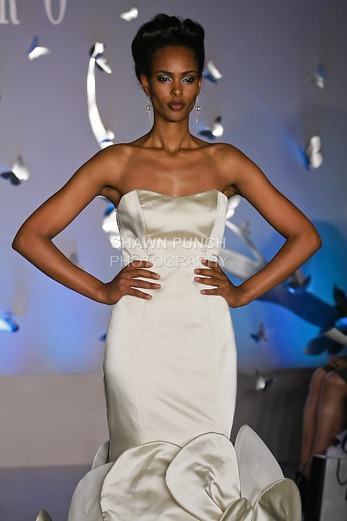 Model walks runway in a Lasaro Fall 2011 bridal dress by Lazaro Perez, for the JLM Couture Fall 2011 Bridal fashion show.