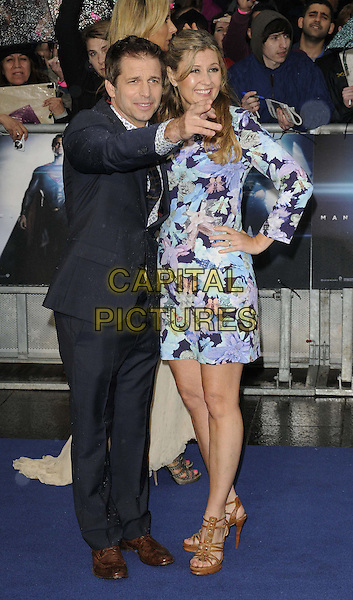 Zack Snyder &amp; Deborah Snyder<br /> 'Man Of Steel' UK film premiere, Empire cinema, Leicester Square, London, England.<br /> 12th June 2013<br /> full length black suit blue pink floral print dress hand on hip married husband wife arm pointing <br /> CAP/CAN<br /> &copy;Can Nguyen/Capital Pictures