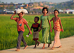 Children walk along a path in the Jamtoli Refugee Camp near Cox's Bazar, Bangladesh. More than 600,000 Rohingya refugees have fled government-sanctioned violence in Myanmar for safety in this and other camps in Bangladesh.