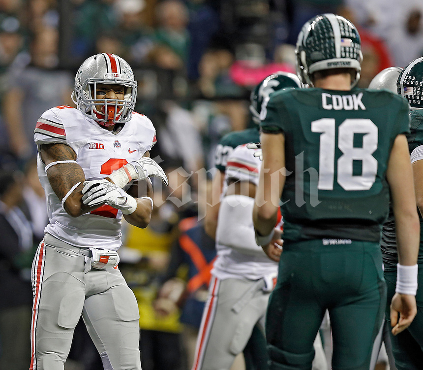 Ohio State Buckeyes linebacker Ryan Shazier (2) talks to Michigan State Spartans quarterback Connor Cook (18) in the 2nd quarter during the Big 10 Championship game at Lucas Oil Stadium in Indianapolis, Ind on December 7, 2013.  (Dispatch photo by Kyle Robertson)