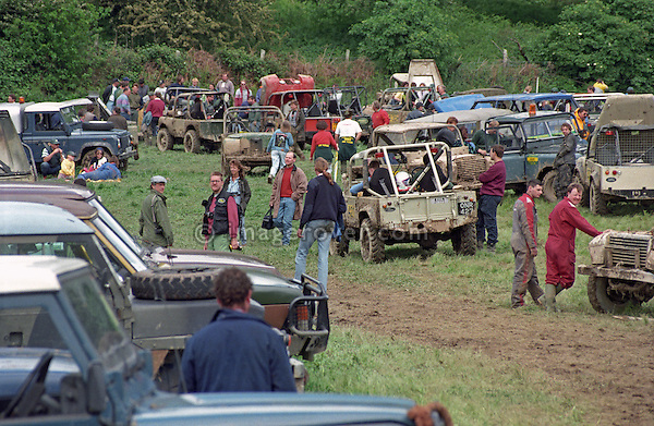 The1993 A.R.C. National Rally busy paddock. The Association of Rover Clubs (A.R.C., since 2006 the Association of Land Rover Clubs ALRC) National Rally is the biggest annual motor sport oriented Land Rover event and was hosted 1993 by the Midland Rover Owners Club at Eastnor Castle in Herefordshire. --- No releases available. Automotive trademarks are the property of the trademark holder, authorization may be needed for some uses.