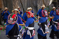 The Ye people provide an insight into their culture as they perform a dance at the Stone Forest in Yunnan province.