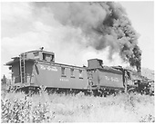 K-37 #495 working as pusher with long caboose #04343 trailing; 1/2 corner view of boxcar 3749<br /> D&amp;RGW    Taken by Krause, John