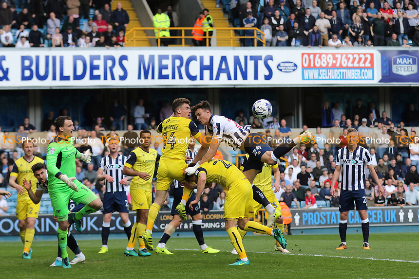Oxford's Joshua Ruffels heads the ball away to foil a Millwall attack during Millwall vs Oxford United, Sky Bet EFL League 1 Football at The Den on 22nd April 2017