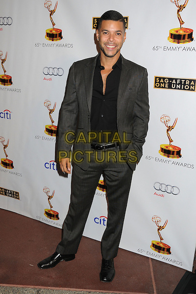 Wilson Cruz<br /> Academy of Television Arts &amp; Sciences' Dynamic and Diverse 2013 Emmy Nominee Reception, North Hollywood, California, USA.<br /> September 17th, 2013<br /> full length black shirt grey gray suit<br /> CAP/ADM/BP<br /> &copy;Byron Purvis/AdMedia/Capital Pictures