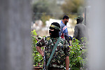 Masked Islamic Jihad militants stand guards during a rally organized by Islamic Jihad marking the first anniversary of Gaza war, in Gaza city, Tuesday, Dec. 31, 2009. Israel launched the three-week long offensive on Dec. 27, 2008, to end years of rocket fire from Gaza toward Israeli border towns. About 1,400 Palestinians were killed, including hundreds of civilians, along with 13 Israelis. Photo by Mohammed Othman