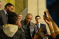 December 22, 2011  (Washington, DC)  Former WBA Junior Welterweight Champion Sharmba Mitchell (center) speaks to local kids after a ceremony for current IBF/WBA Junior Welterweight Champion Lamont Peterson, who was given the key to the city by District of Columbia Mayor Vincent Gray.   (Photo by Don Baxter/Media Images International)