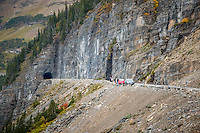 Going-to-the-Sun Road is the only road that crosses Glacier National Park in Montana, USA, going over the Continental Divide at Logan Pass. It was completed in 1932. The road, a National Historic Landmark and a Historic Civil Engineering Landmark, spans 53 miles across the width of the park.<br /> <br /> The road is one of the most difficult roads in North America to snowplow in the spring. Up to 80 feet of snow can lie on top of Logan Pass, and more just east of the pass where the deepest snowfield has long been referred to as Big Drift. The road takes about ten weeks to plow, even with equipment that can move 4000 tons of snow in an hour. The snowplow crew can clear as little as 500 feet of the road per day. On the east side of the continental divide, there are few guardrails due to heavy snows and the resultant late winter avalanches that have repeatedly destroyed every protective barrier ever constructed. The road is generally open from early June to mid October, with its latest-ever opening on July 13, 2011. <br /> <br /> The two lane Going-to-the-Sun Road is quite narrow and winding, especially west of Logan Pass. Consequently, vehicle lengths over the highest portions of the roadway are limited to 21 feet and that means no recreational vehicles or trailers in excess of this length restriction are permitted beyond two larger parking areas, each located at lower points dozens of miles below Logan Pass, on both the west and east sides of the parkway.